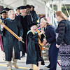 MassBay Registrar Ali Guvendiren carries the Ceremonial Mace and accompanies Commencement Marshal, Maxine Elmont, Ed.D., Professor, Human Services